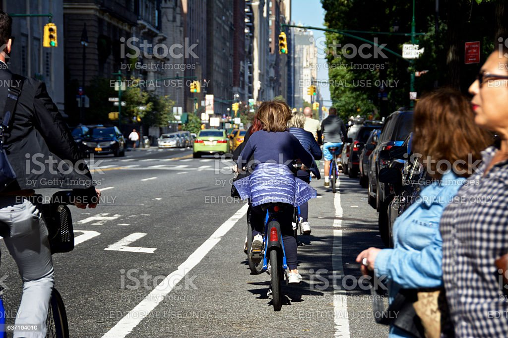 Urban Life, New York City, Female Bicyclists Passing Pedestrians, Manhattan stock photo