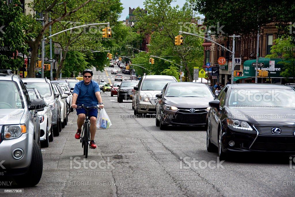 Urban Life, New York City, Male Bicyclist Near Vehicles, Brooklyn stock photo