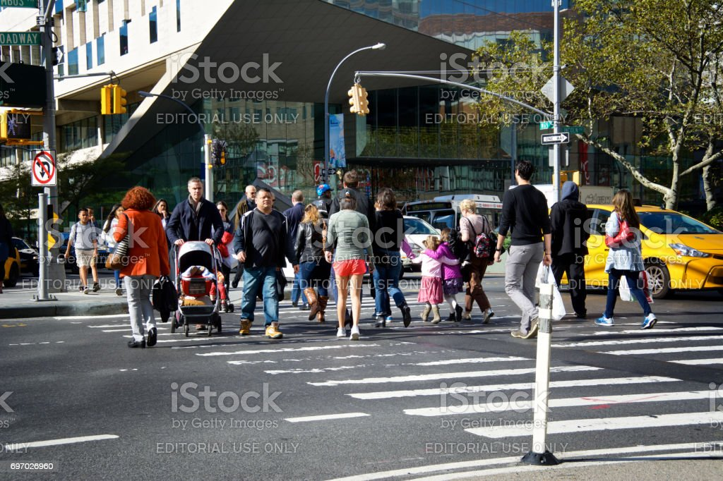 Urban Life, New York City, Pedestrians crossing Broadway, Upper West Side, Manhattan stock photo