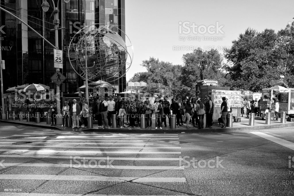 Urban Life, New York City, Pedestrians Waiting to Cross Street at Columbus Circle, Manhattan stock photo
