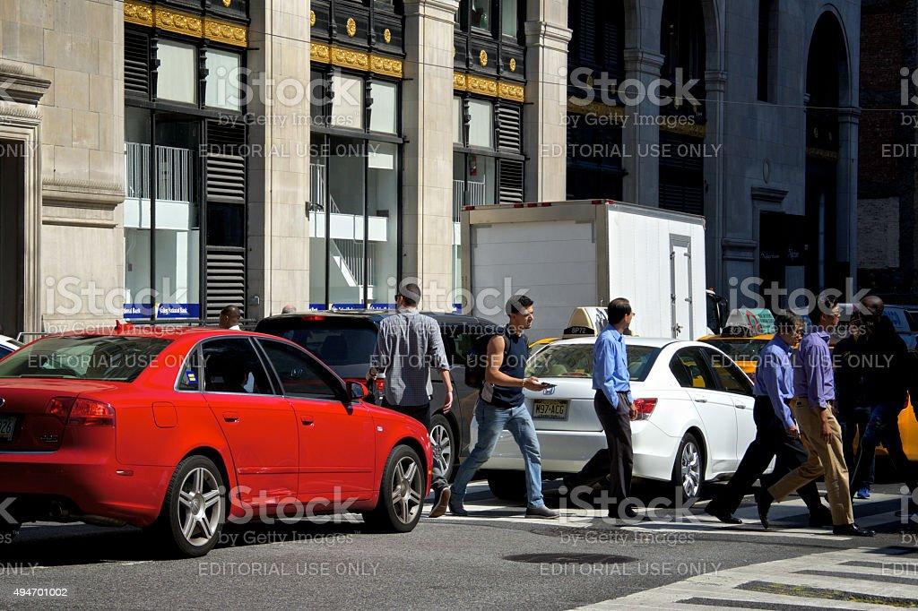 Urban Life, New York City, Pedestrians Walking Between Automobiles, Manhattan stock photo