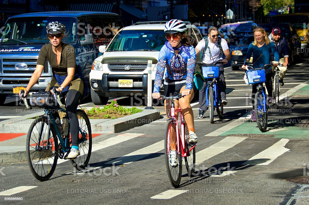 NYC Urban Life, Women and Men Bicyclists, Upper West Side stock photo