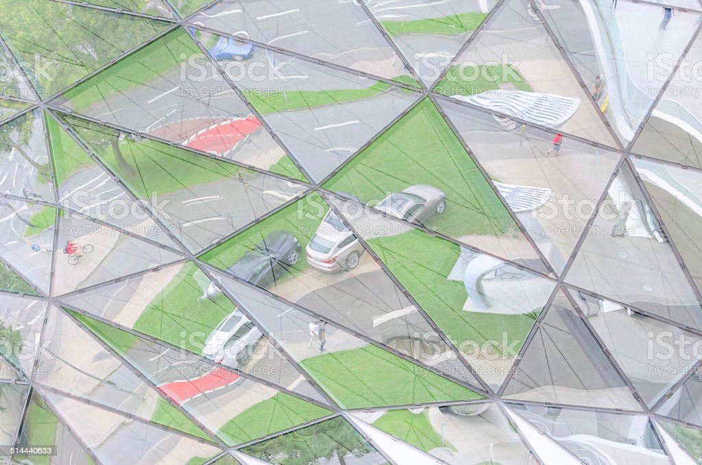 Urban lifestyle reflected in mirrored glass wall stock photo