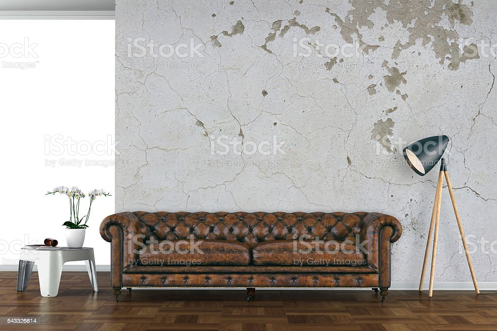 Urban living room with leather sofa stock photo