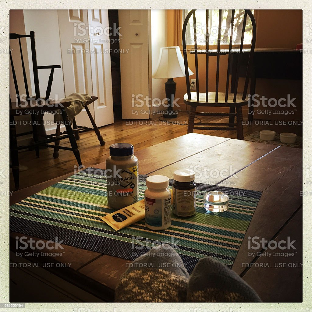 Urban Living Space with Vitamins on Table stock photo