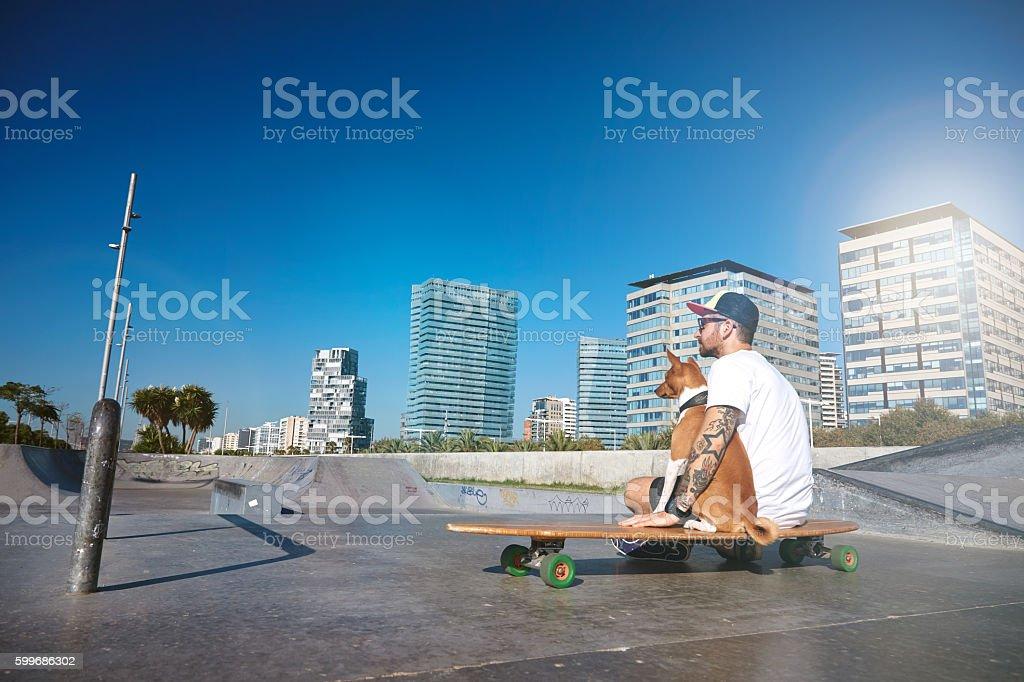 Urban longboarding in concrete skatepark stock photo