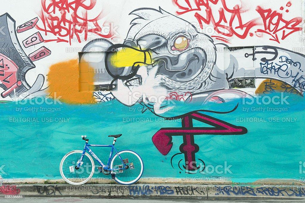 Urban Miami Wynwood Bike Parked by Graffiti Street Art Mural stock photo