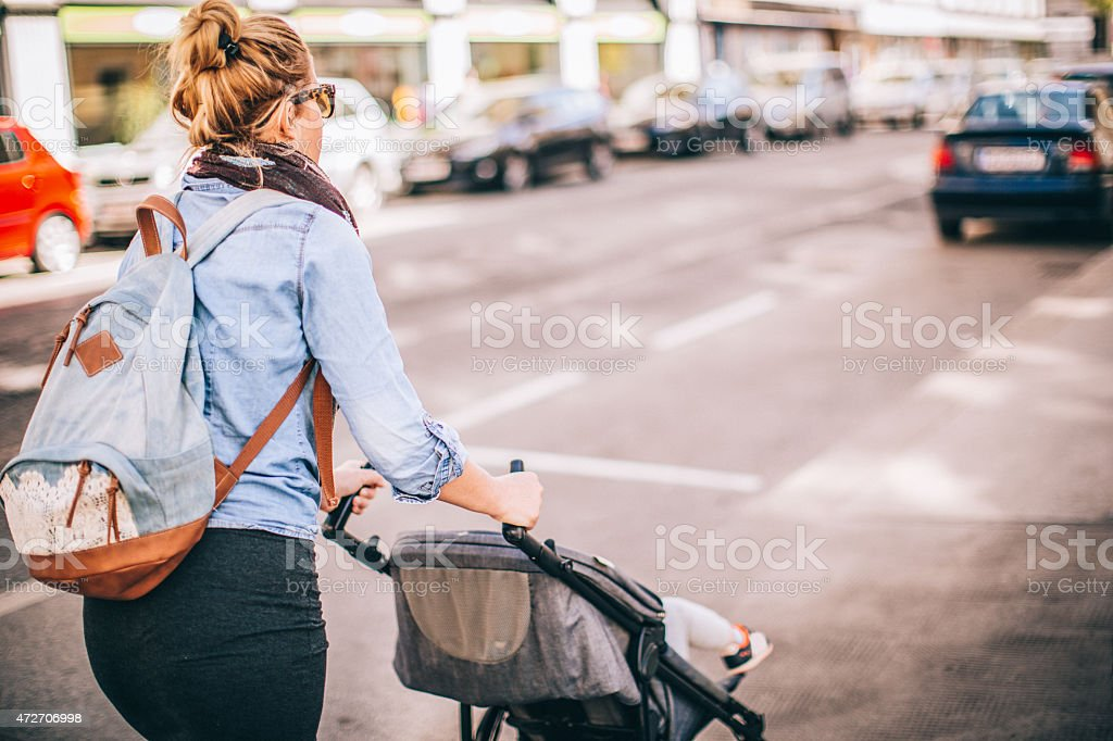 Urban mom with a buggy stock photo