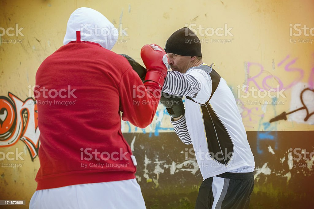 Urban outdoor boxing training in the slums of Eastern Europe stock photo