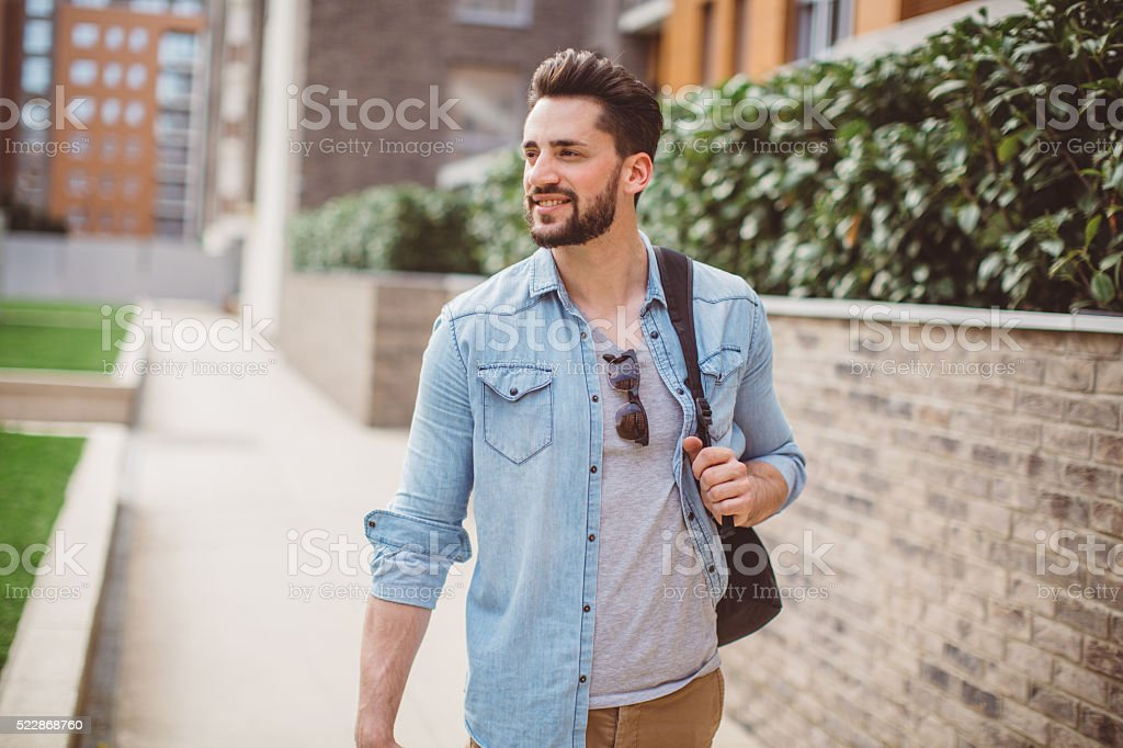 Urban professional man on road to work stock photo