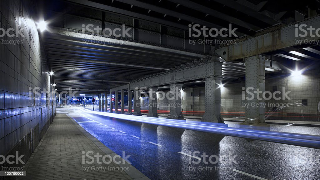 Urban road tunnel with light trails at night, Amsterdam royalty-free stock photo