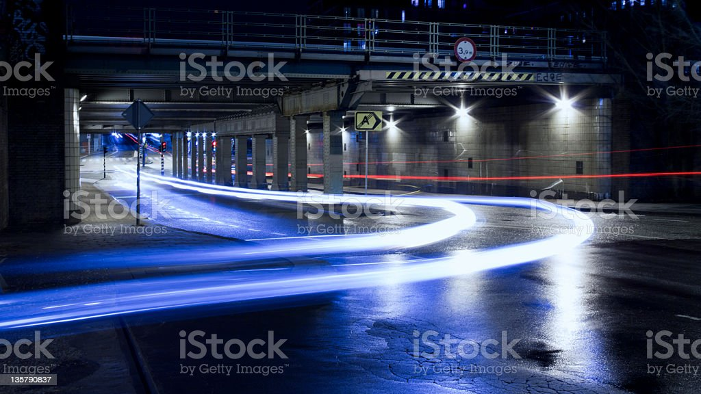 Urban road with light trails at night in Amsterdam royalty-free stock photo