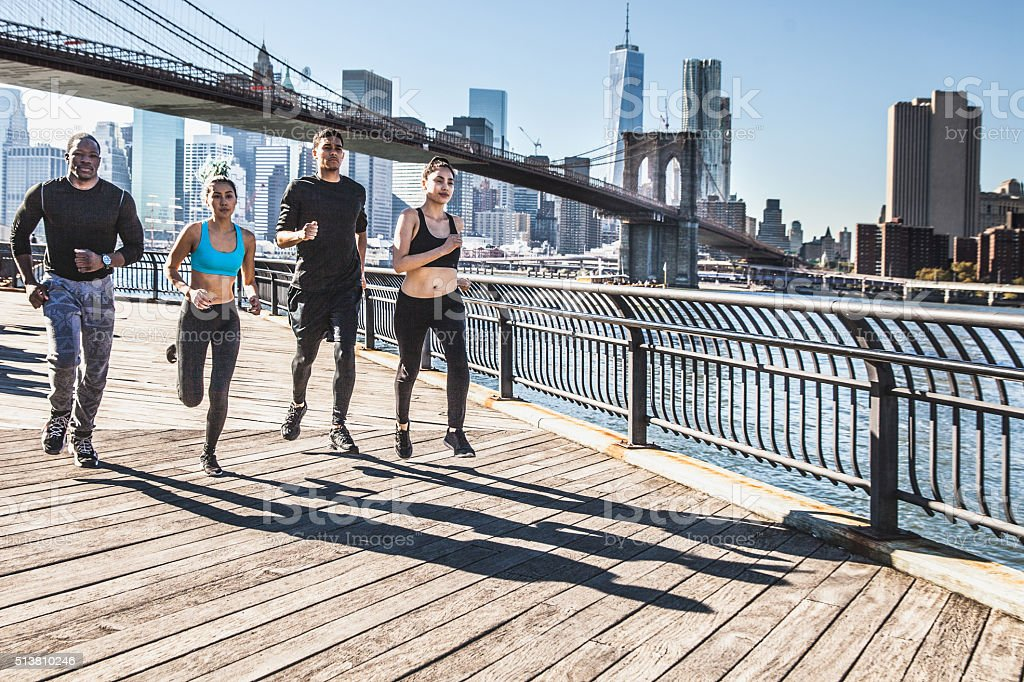 Urban runners - New York - Brooklyn Bridge stock photo