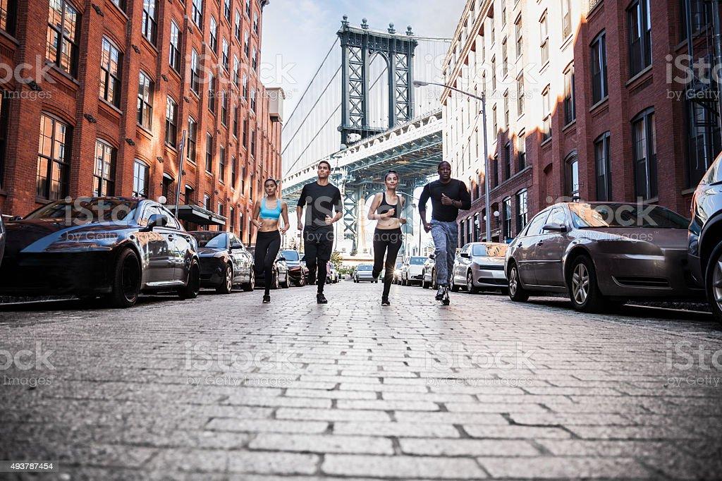 Urban runners running in DUMBO - New York streets stock photo