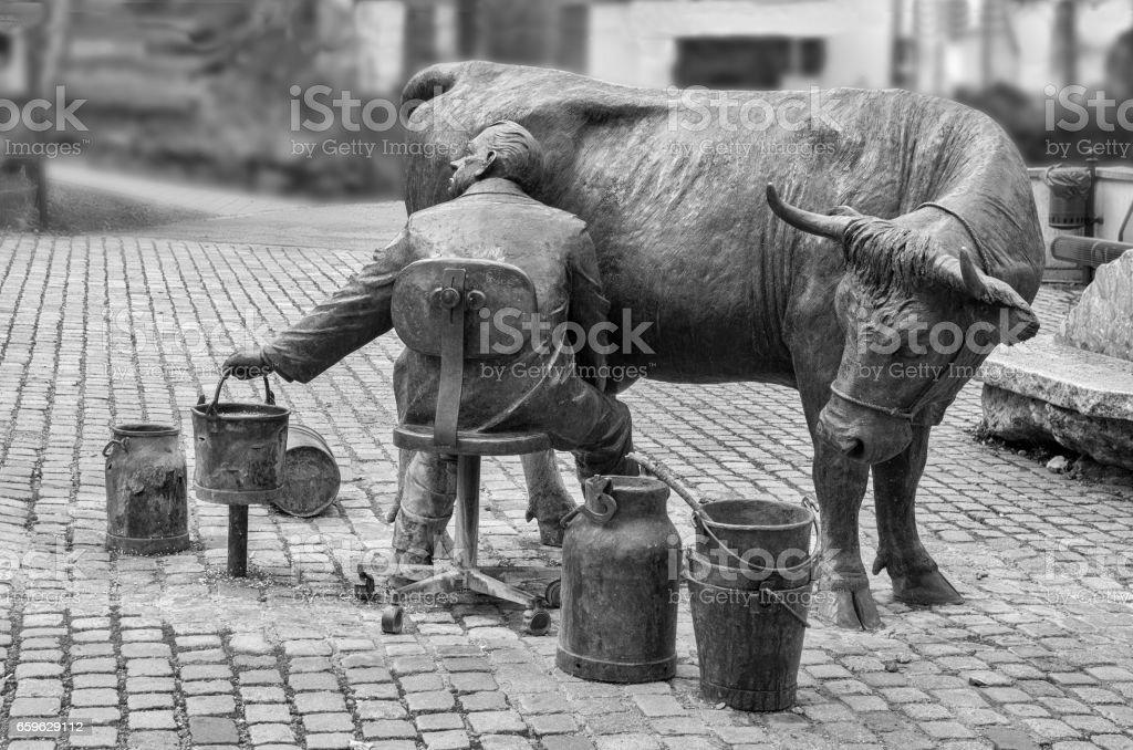 Urban sculpture of a farmer stock photo