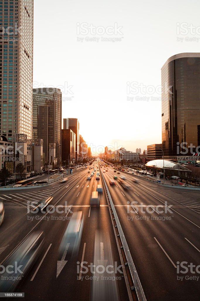 Urban traffic in sunset of Beijing CBD stock photo