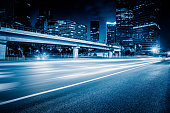 urban traffic road with cityscape at night