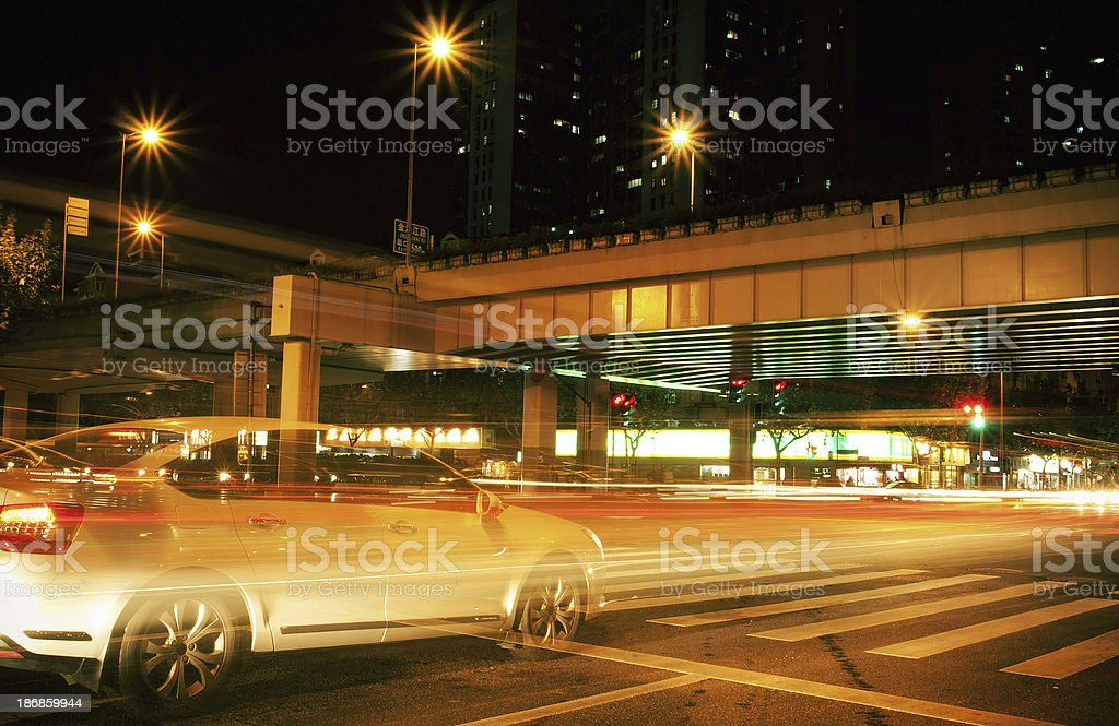 Urban traffic with light trails at night stock photo