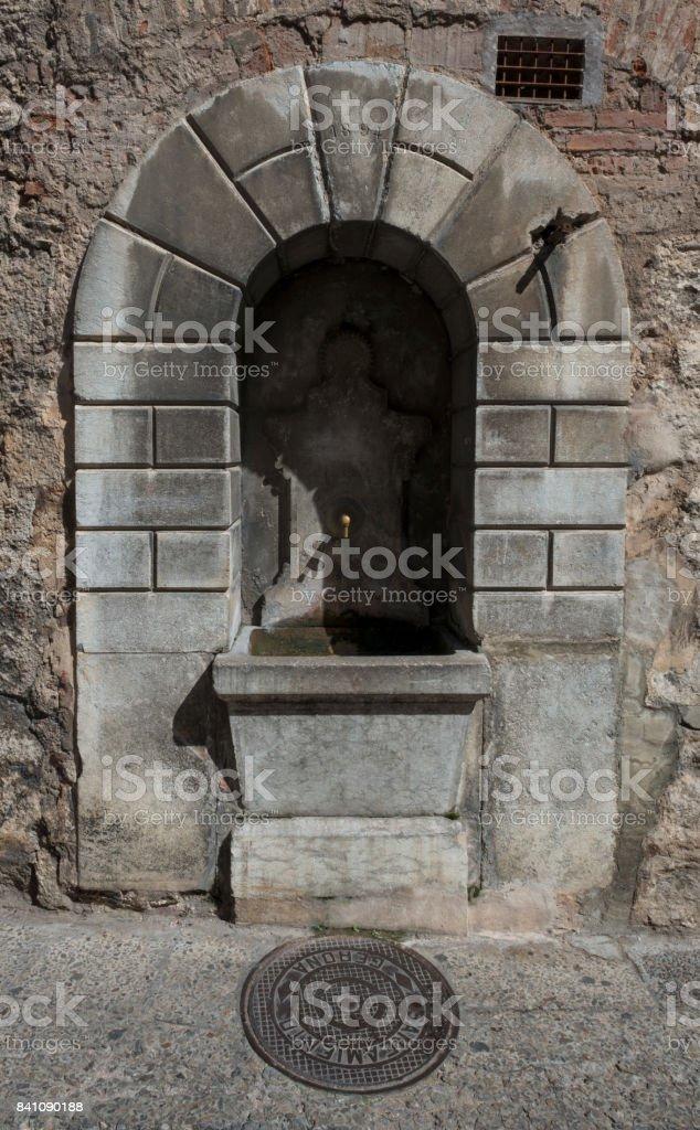 Urban water fountain in Girona stock photo