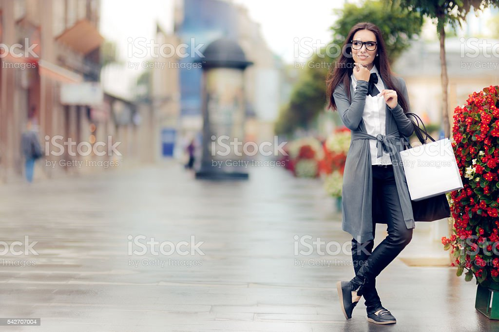 Urban  Woman With Shopping Bags Outside stock photo