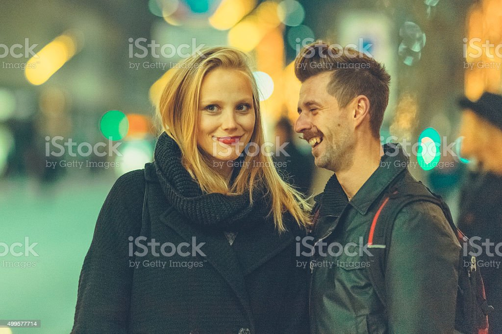 Urban young couple talking on the streets stock photo