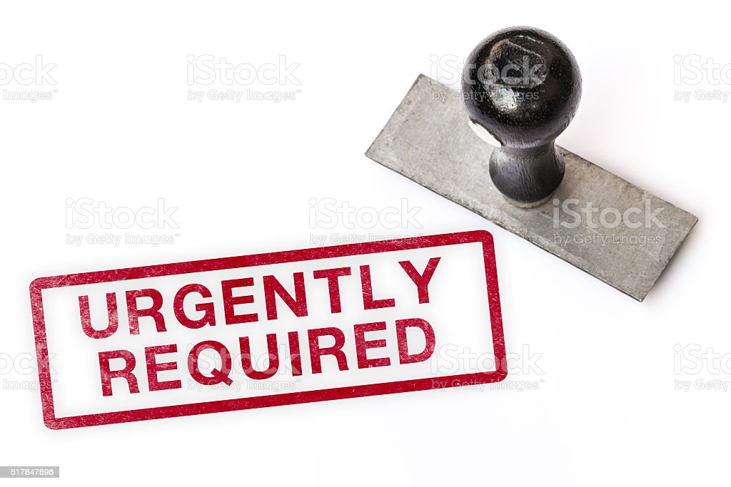 urgently required text label stamp for documents. stock photo