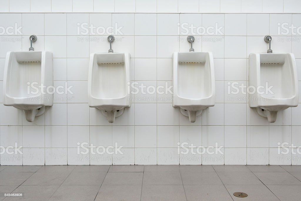 Urinals in public toilet. public restroom for men. stock photo