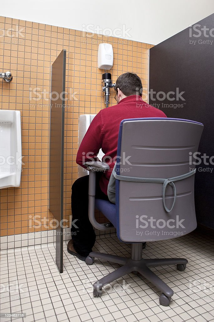 Urinating Business Man - Bathroom Humor stock photo