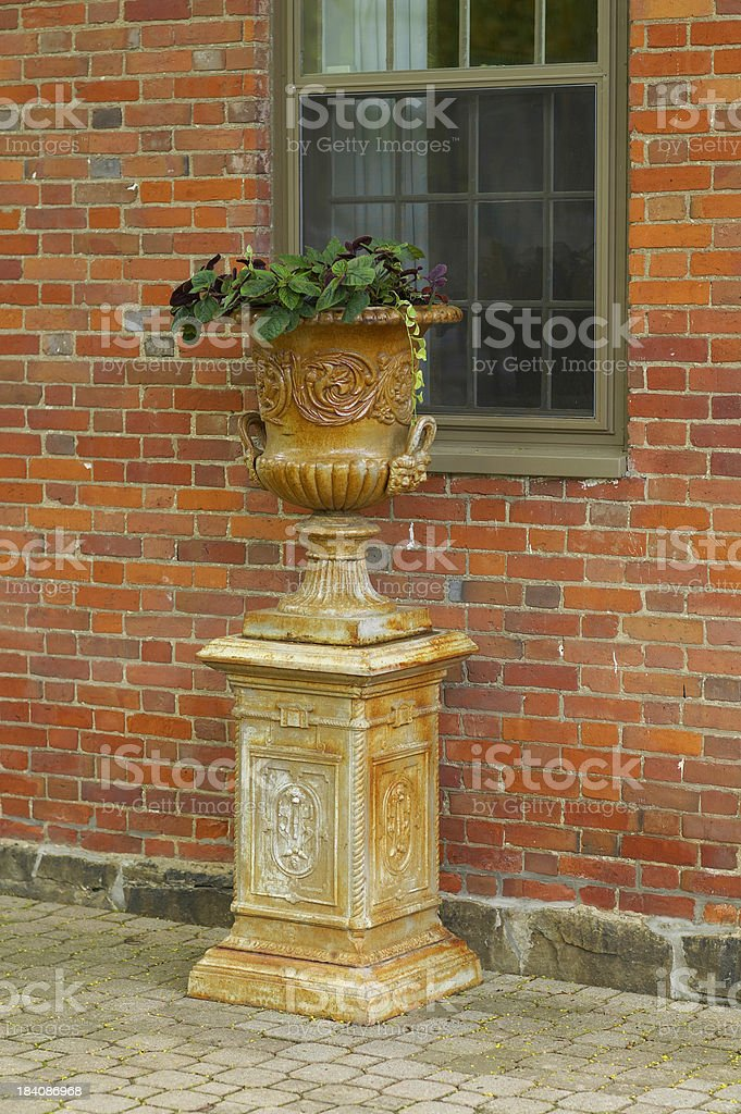Urn by the window stock photo