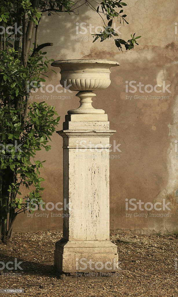 Urn on a pedestal in Rome, Italy royalty-free stock photo