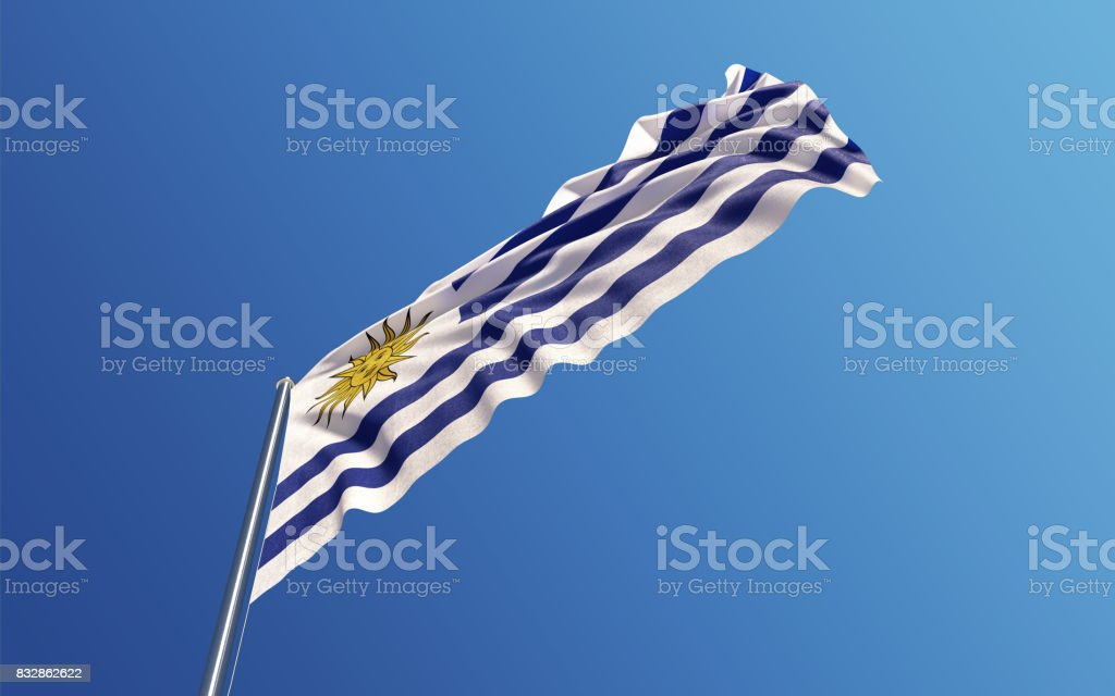Uruguaian Flag Waving With Wind On Blue Sky stock photo