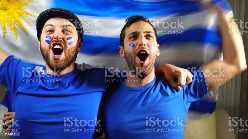 Uruguaian Friends Waving Uruguay Flag stock photo