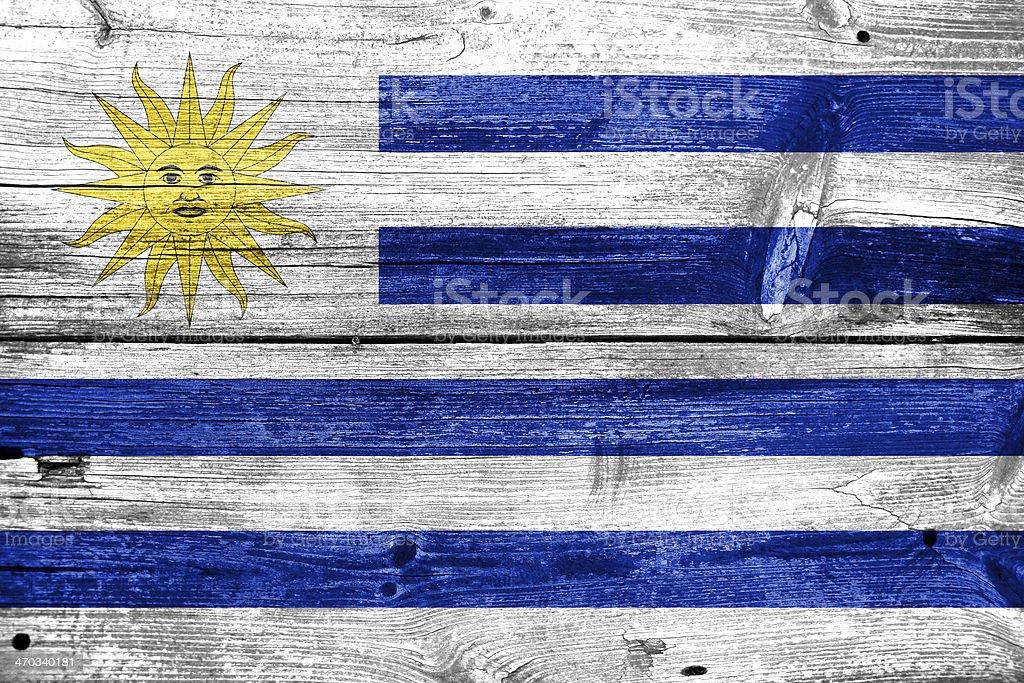 Uruguay Flag painted on old wood plank texture stock photo