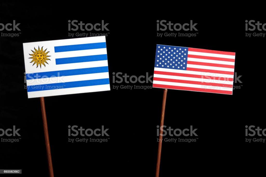 Uruguay flag with USA flag isolated on black background stock photo