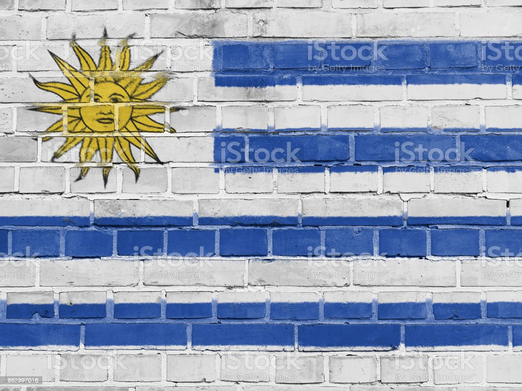 Uruguay Politics Concept: Uruguayan Flag Wall Background Texture stock photo