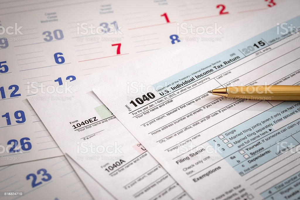 us 1040 tax form with calendar stock photo