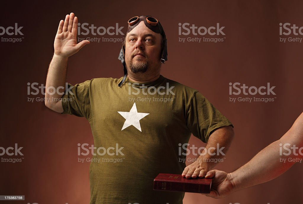 us airman swears allegiance  on bible stock photo