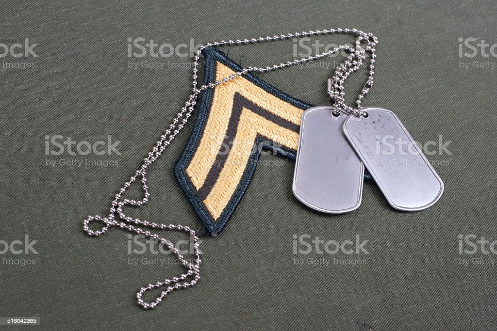 us army uniform with blank dog tags and rank patch stock photo