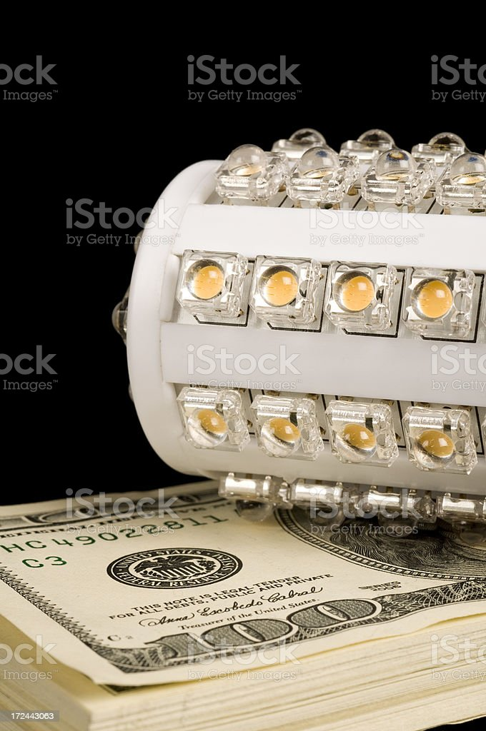 Us currency and led bulb royalty-free stock photo