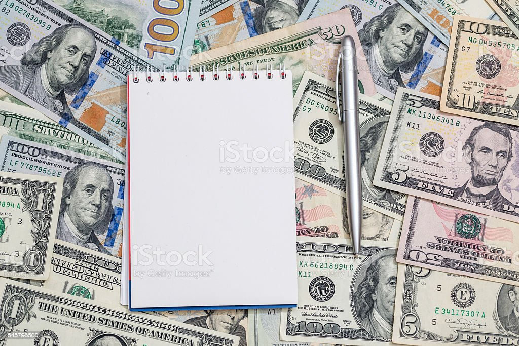us dollar with pen and notepad stock photo