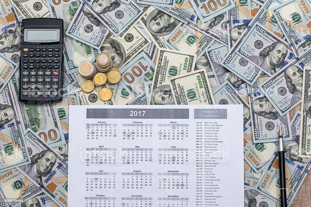 Us Dollars, calculator, pen and calendar. stock photo
