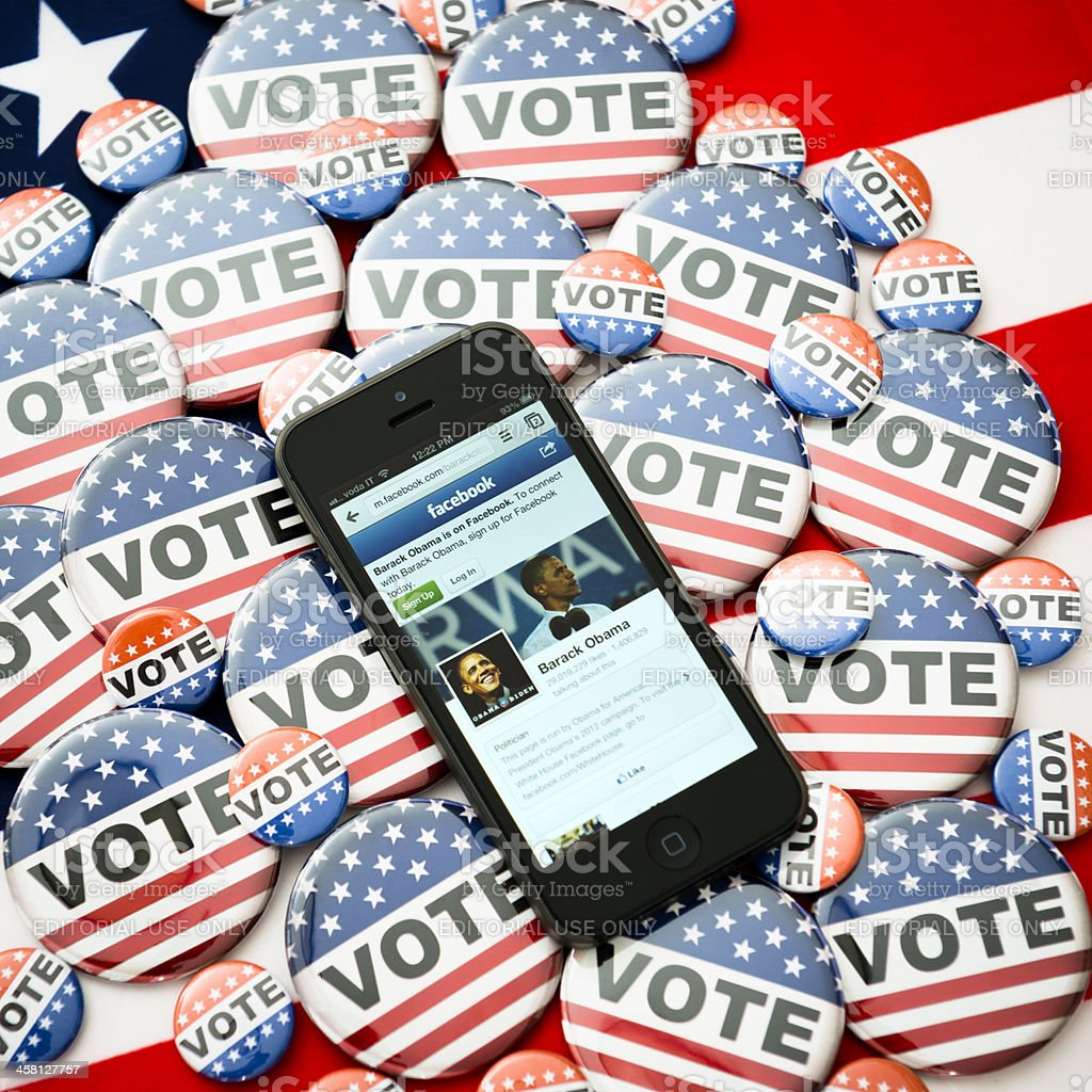 Us election 2012 Barack Obama in the iphone 5 screen stock photo
