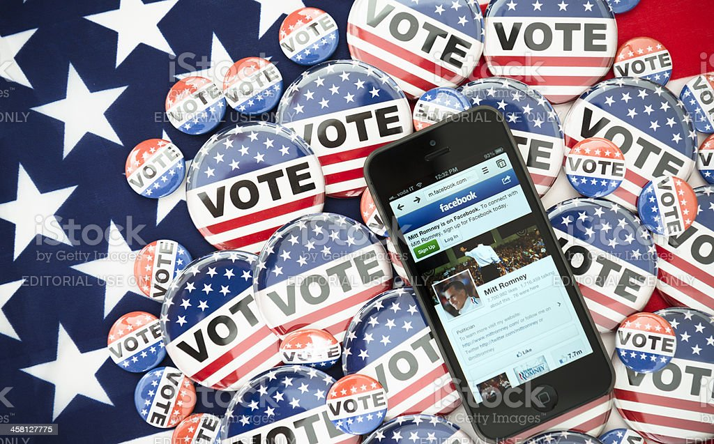 Us election 2012 Mitt Romney in the iphone 5 screen stock photo
