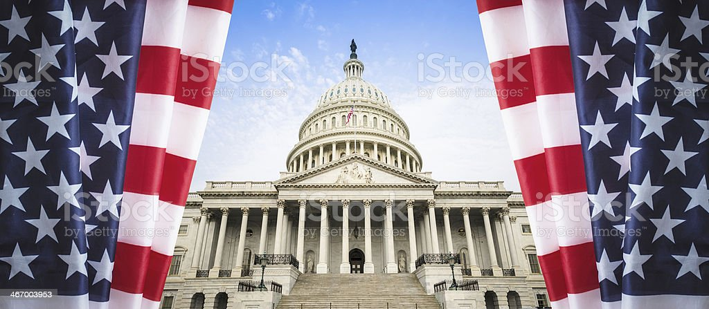 Us flag on washington dc capitol building royalty-free stock photo