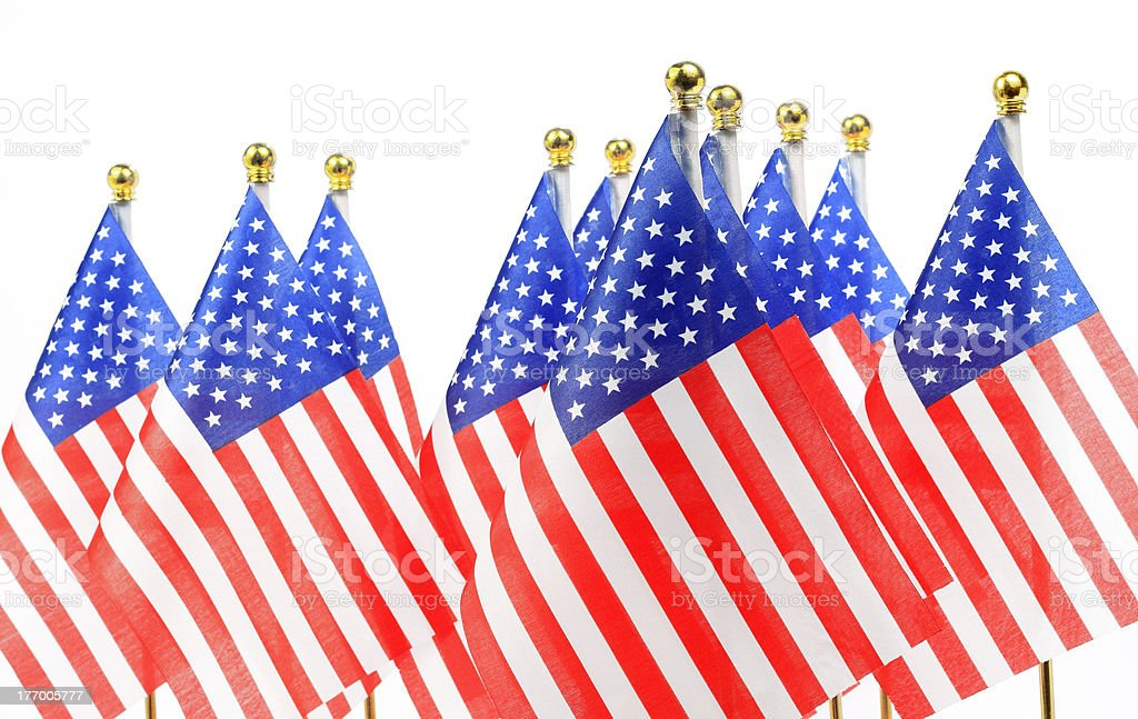 us flags hanging on the gold flagpole stock photo