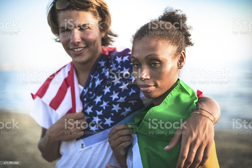 Us guy and brazilian woman embracing for fraternity royalty-free stock photo