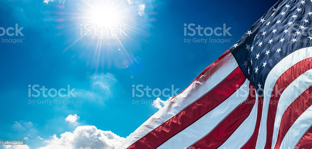 us national flag waving on the wind stock photo