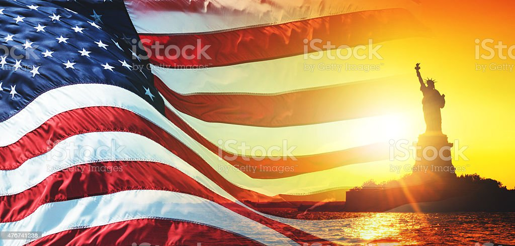 us national flag waving with with statue of liberty stock photo