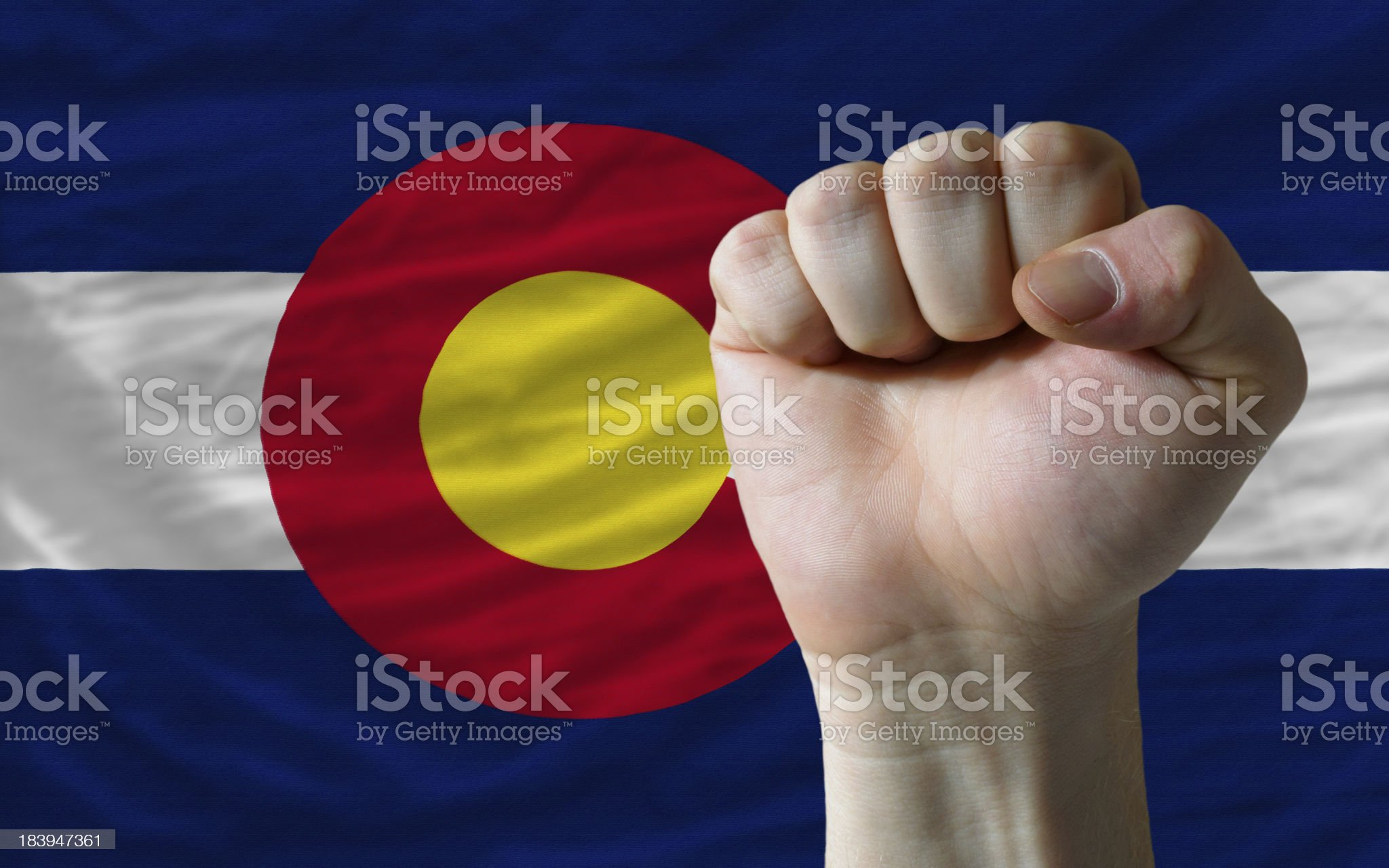 us state flag of colorado with hard fist in front royalty-free stock photo