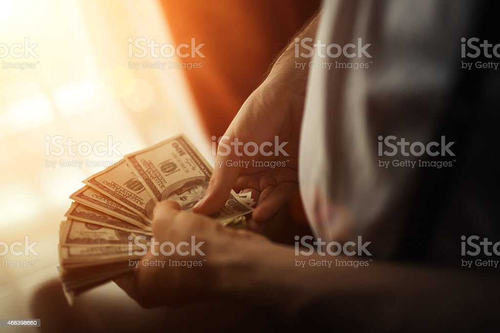 usa dollars in hands stock photo